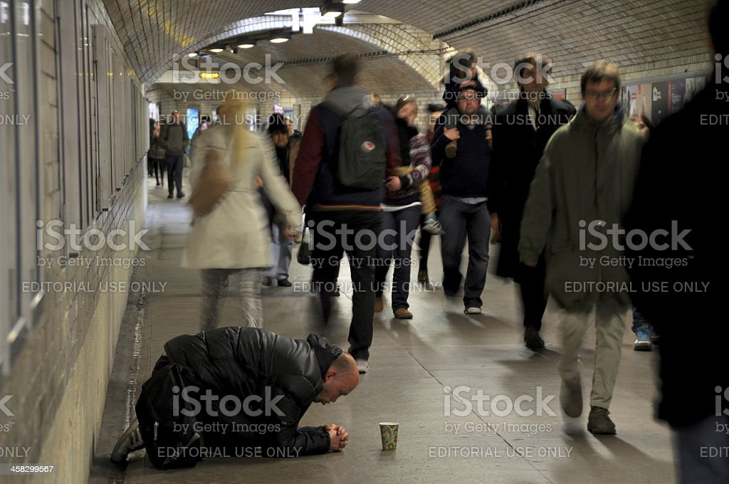 Homeless Man Begging In The Subway royalty-free stock photo