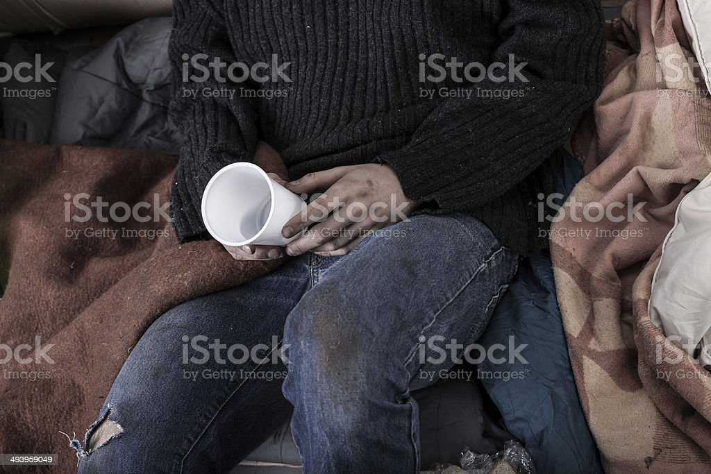 Homeless man collecting money royalty-free stock photo
