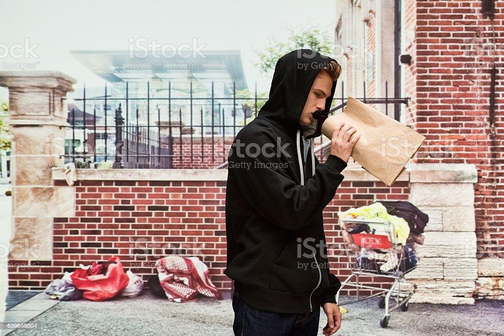Homeless man drinking alcohol outdoors stok fotoğrafı