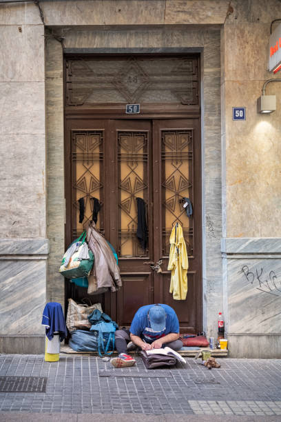 Homeless man in a doorway stock photo