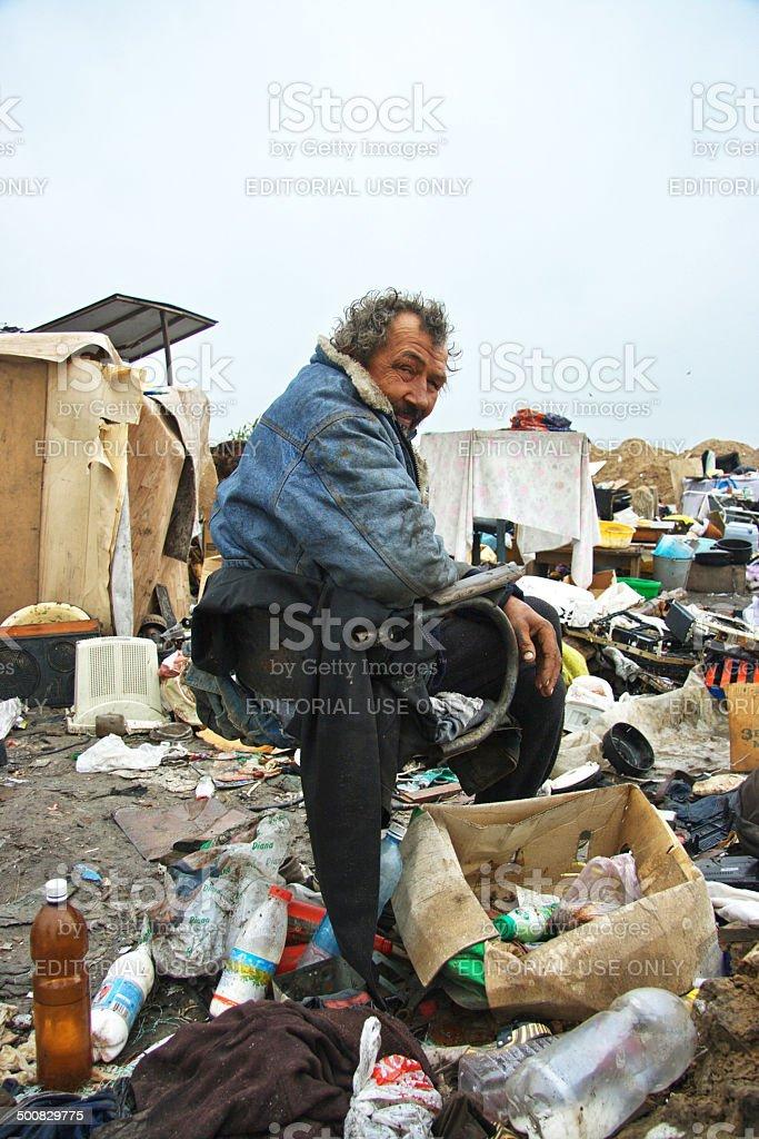 Homeless man in a dump stock photo