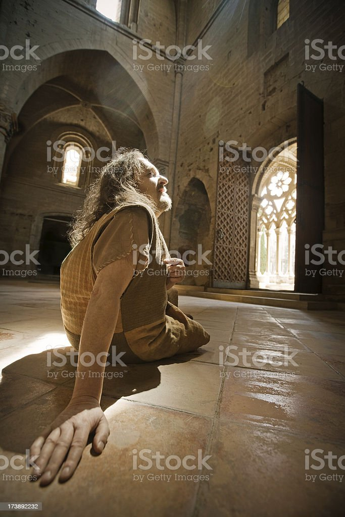 homeless man in church royalty-free stock photo