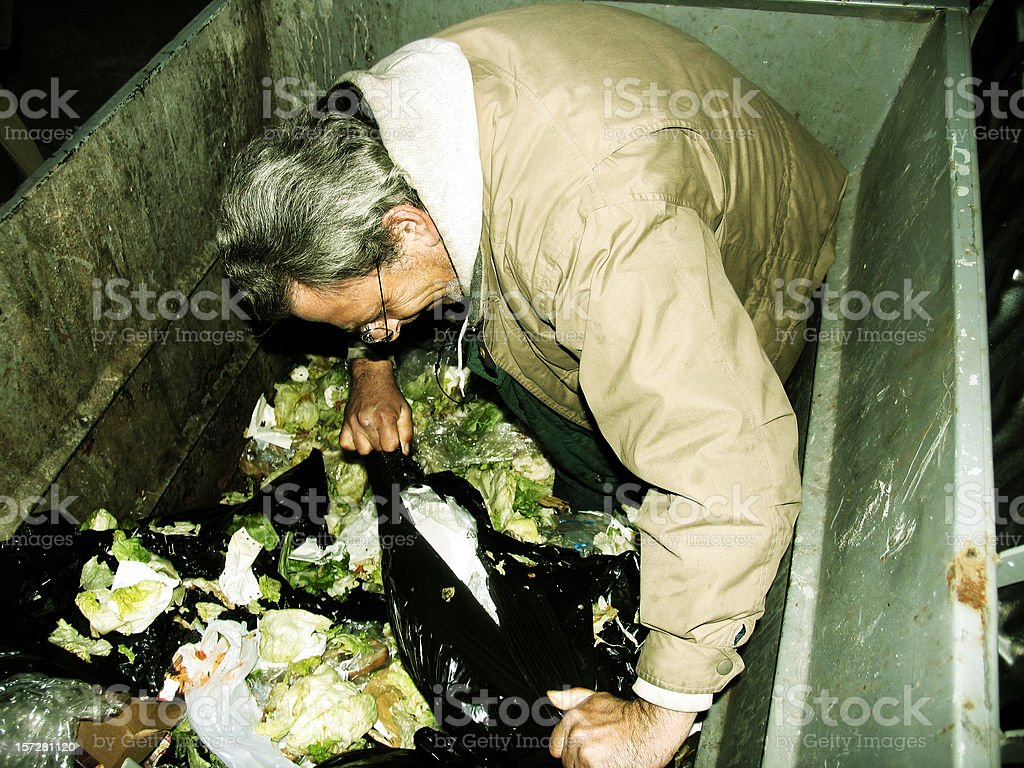 Homeless Man In Dumpster royalty-free stock photo