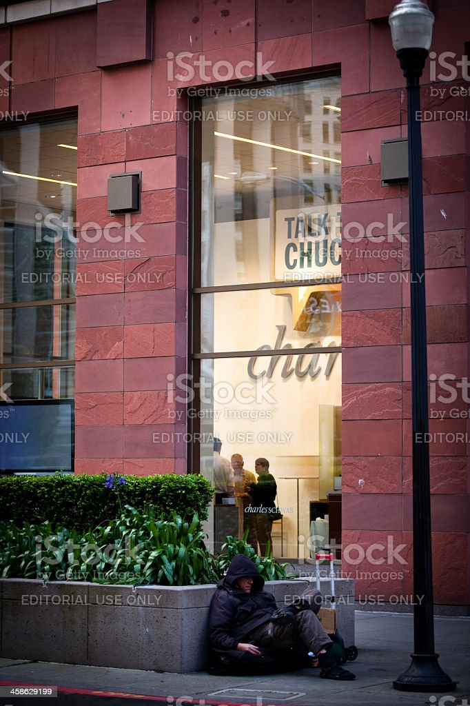Homeless Man in front of Charles Schwab stock photo