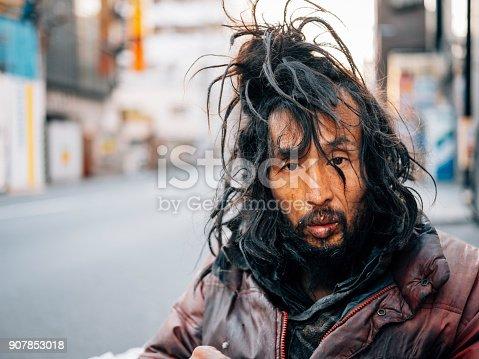 istock Homeless Man in Tokyo Japan 907853018