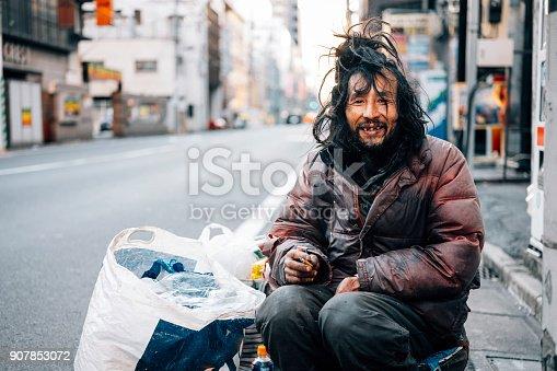 istock Homeless Man in Tokyo Japan 907853072