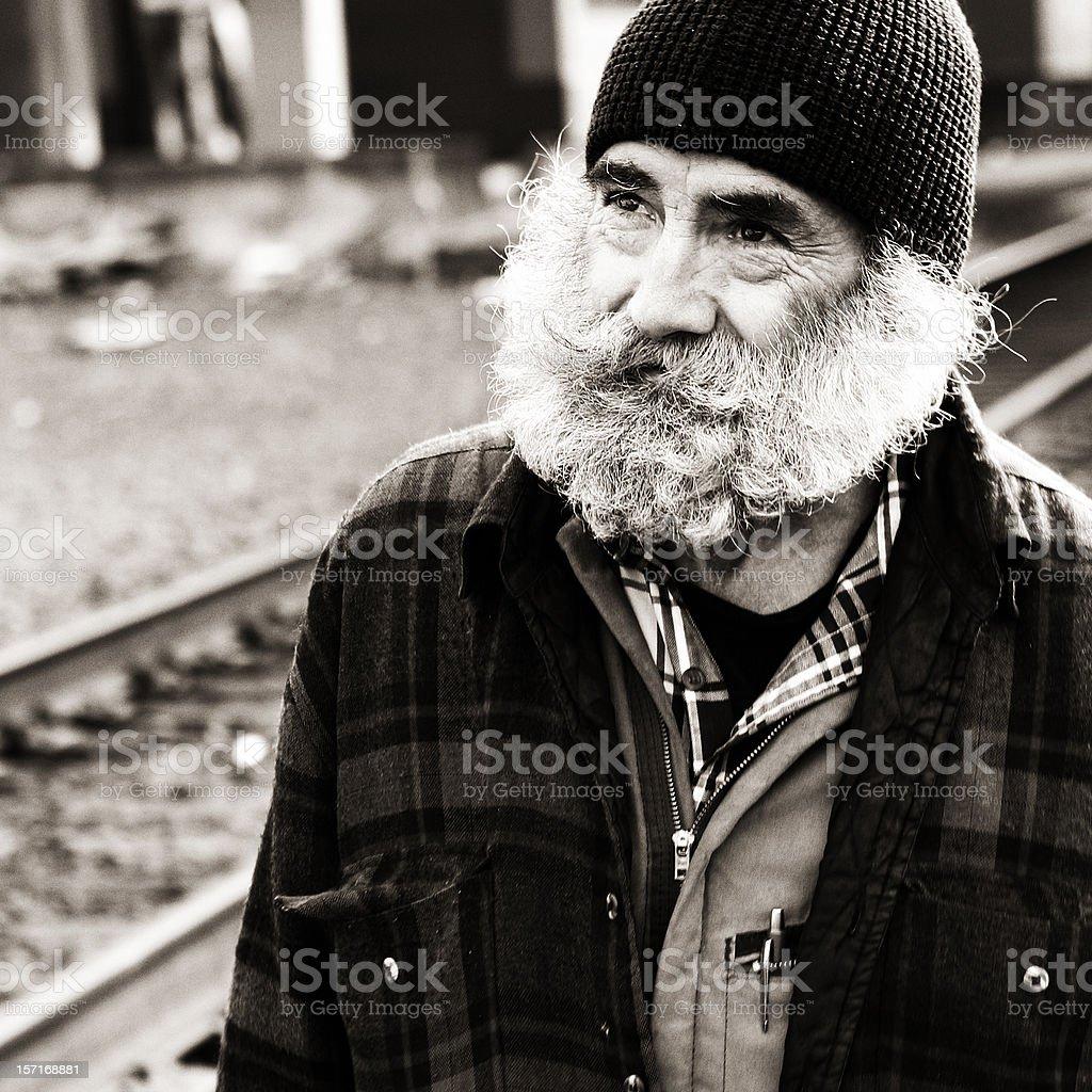 Homeless Man Looking Up Towards the Sky stock photo