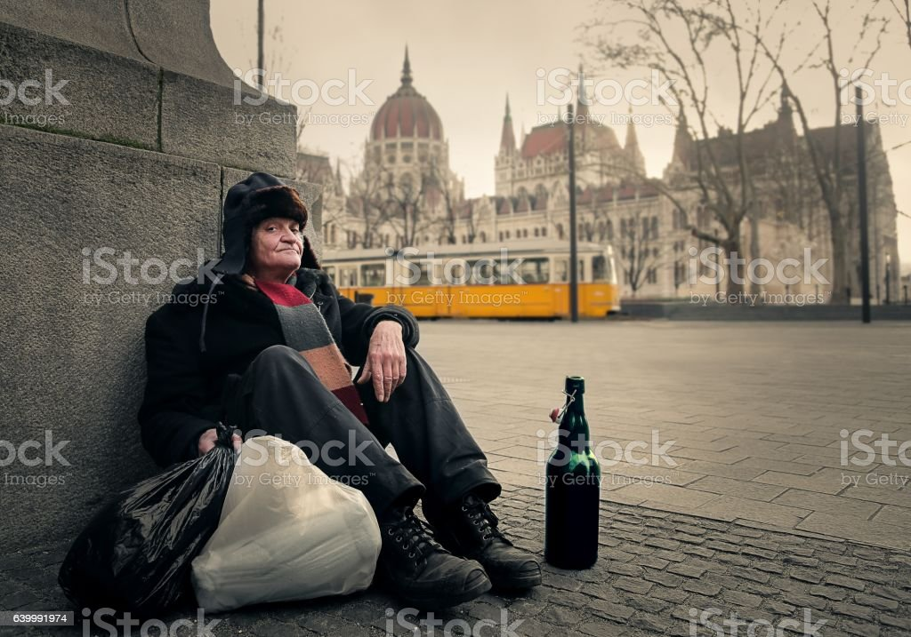 Homeless man on the street stock photo