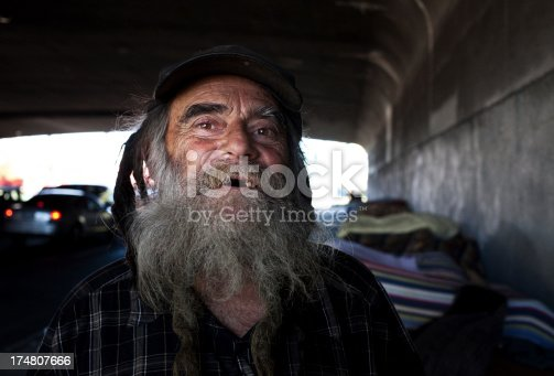 homeless man under a bridge