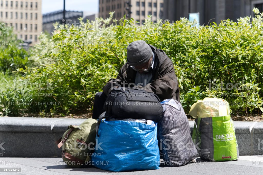 Homeless man rests outside in Center City Philadelphia, PA royalty-free stock photo