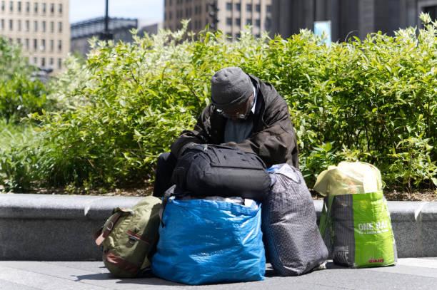 Homeless man rests outside in Center City Philadelphia, PA stock photo