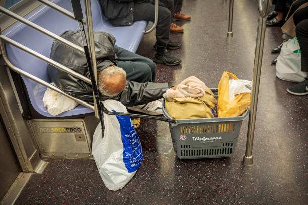 Homeless man sleeping in the subway stock photo