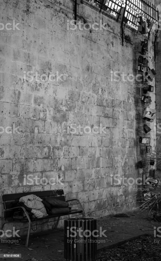 A homeless man sleeping. stock photo