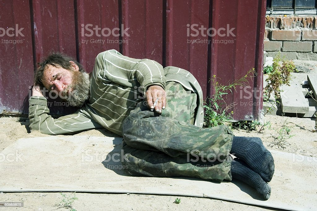 Homeless man sleeping royalty-free stock photo