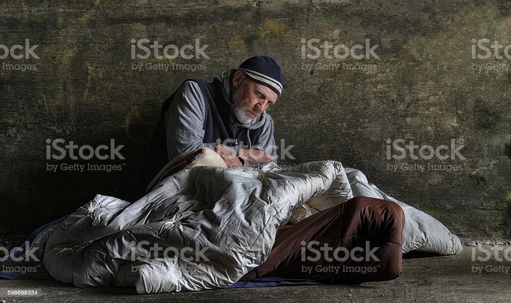 homeless man sleeping rough stock photo