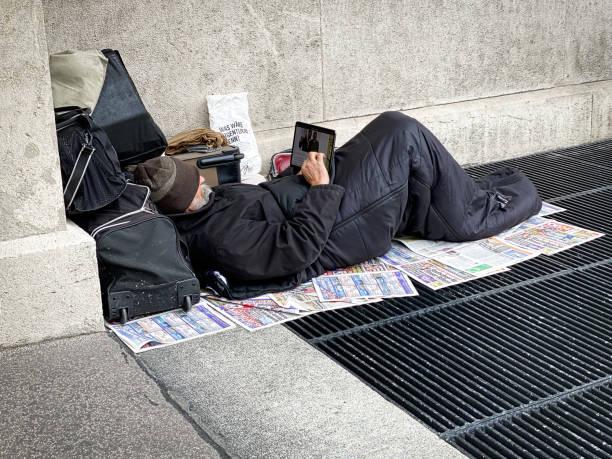 Homeless Man Surfing the Net stock photo