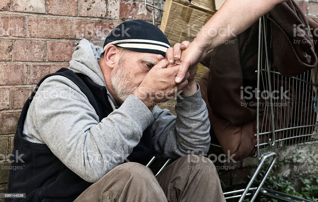 Homeless man taking a woman's hand royalty-free stock photo