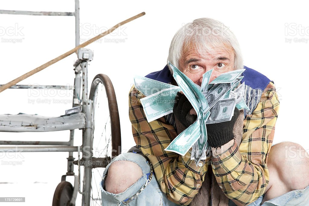 homeless man with a lot of money stock photo