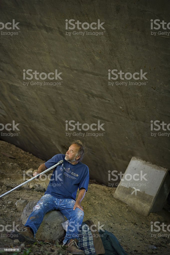 Homeless man with crutches royalty-free stock photo