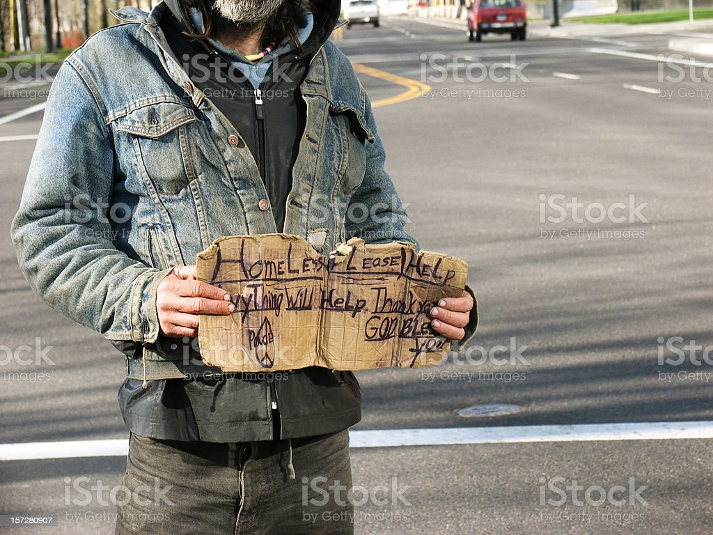Homeless Man with Dirty Old Sign stock photo