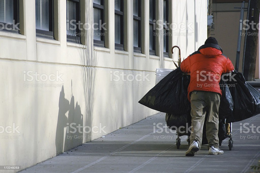 Homeless man with shopping cart royalty-free stock photo