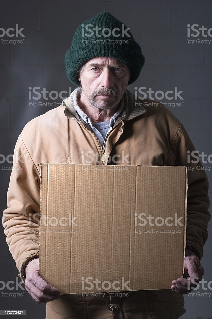 Homeless Man with Sign stock photo