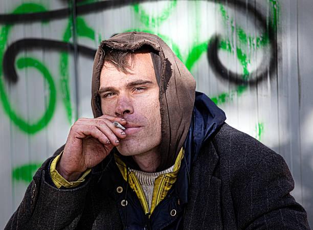 Homeless Men smoking stock photo