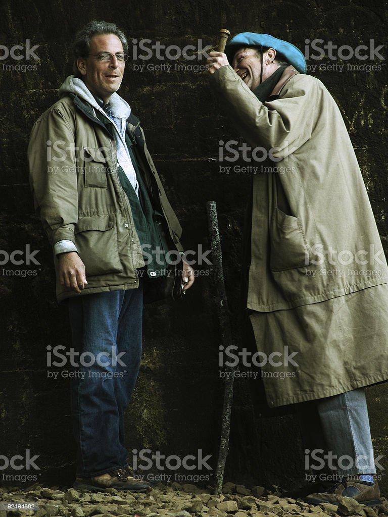 Homeless Men Telling Each Other Jokes royalty-free stock photo
