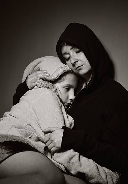 Homeless mother with her daughter. Poor family. stock photo