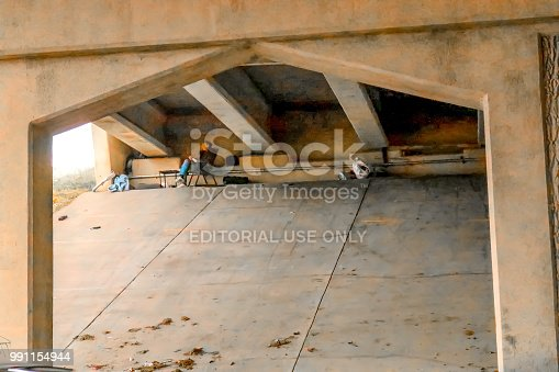 Homeless person who has set up table and chair beneath overpass in the winter Tulsa Oklahoma USA2 28 2018
