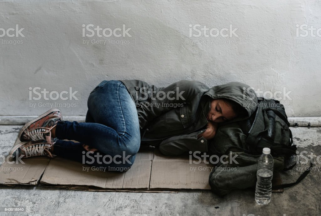 Homeless sleeping on the sidewalk stock photo