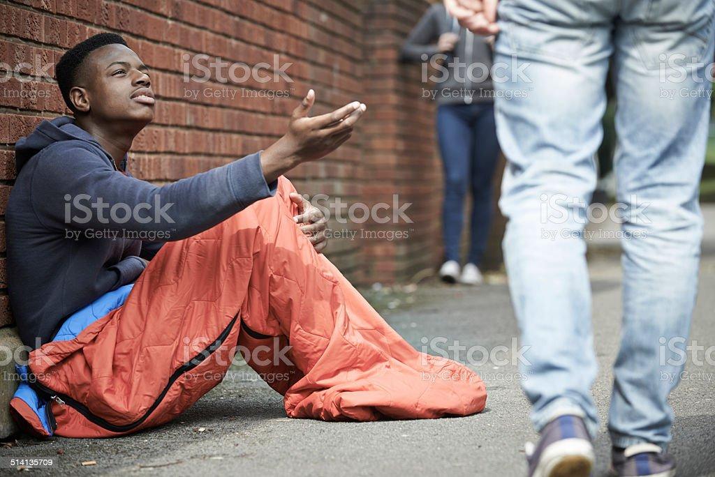Homeless Teenage Boy Begging For Money On The Street stock photo