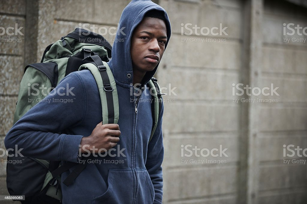 Homeless Teenage Boy On Streets With Rucksack stock photo