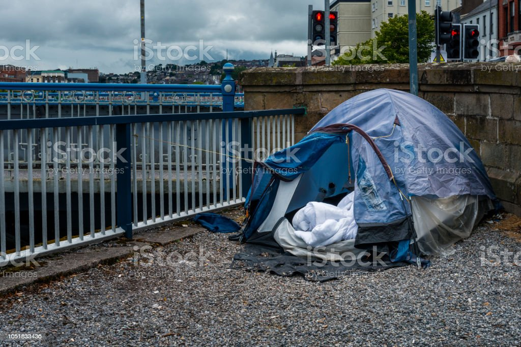 homeless tent by the river stock photo