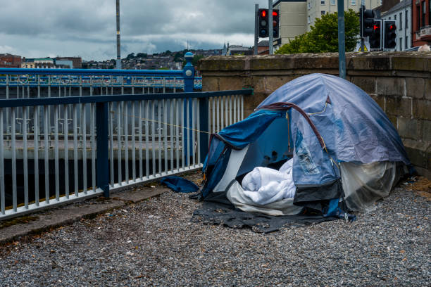 homeless tent by the river - homelessness stock photos and pictures