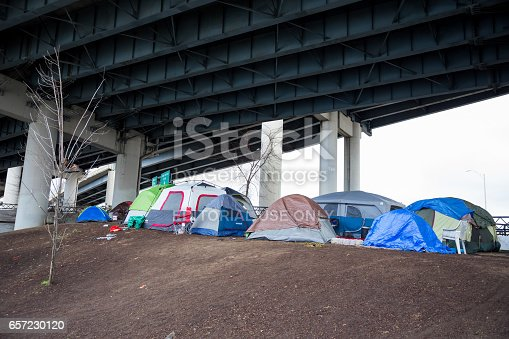 Portland, DeepMeta.Shared.Country: Homeless camps with tents and tarp shelter under a bridge in downtown Portland Oregon.