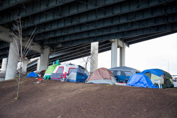 homeless tent camp portland oregon - homelessness stock photos and pictures