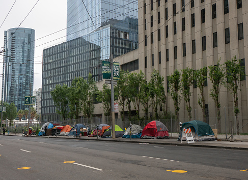 May 10, 2020  Homeless tents line Main Street in San Francisco's financial district during shelter in place order. Tents are surrounded by modern skyscrapers in an affluent area of the city.