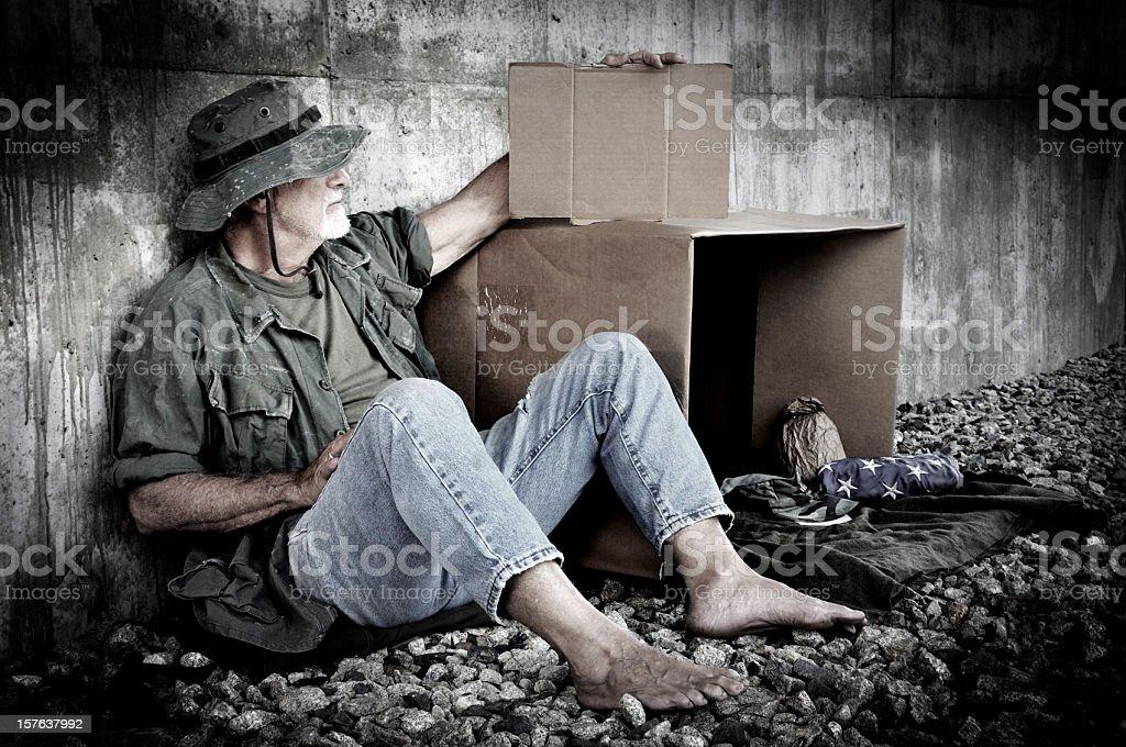 Homeless Veteran Holds Blank Cardboard Sign stock photo