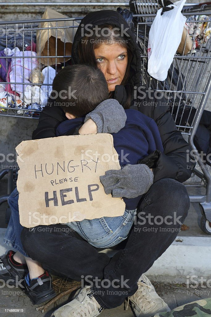 Homeless Woman Holds Son Vertical royalty-free stock photo