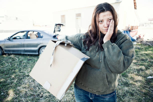 homeless woman living out of a car - homelessness stock photos and pictures