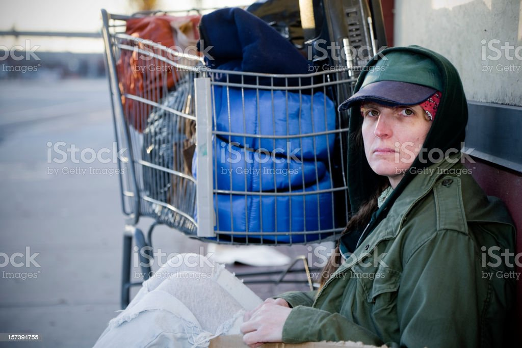 Homeless Woman on a City Street stock photo