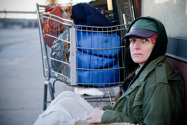 homeless woman on a city street - homelessness stock photos and pictures