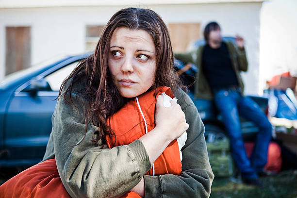 Homeless Woman A stock photo of a woman and man living out of their car after loosing their home. sheltering stock pictures, royalty-free photos & images