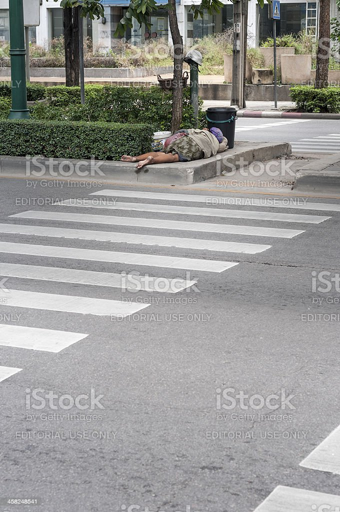 Homeless woman Sleeping On The Streets In Bangkok, Thailand royalty-free stock photo
