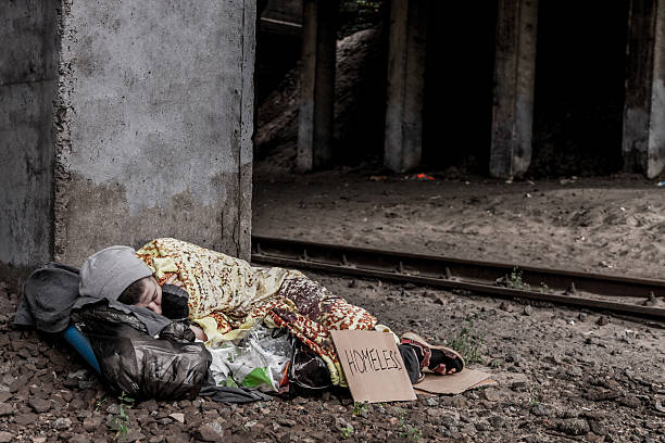 homeless woman sleeping - homelessness stock photos and pictures