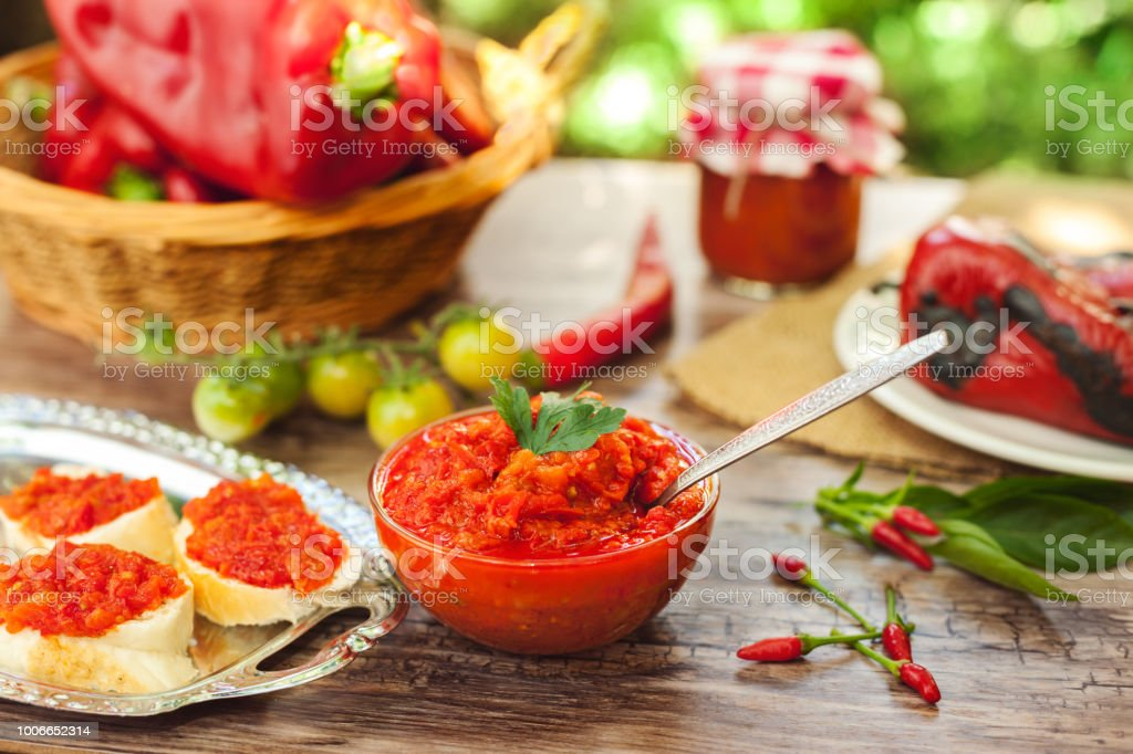 Homemade ajvar in bowl with spoon stock photo