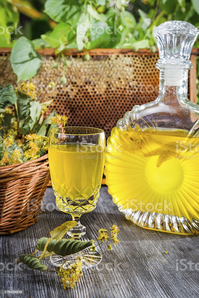 Homemade alcohol based on honey and lime royalty-free stock photo