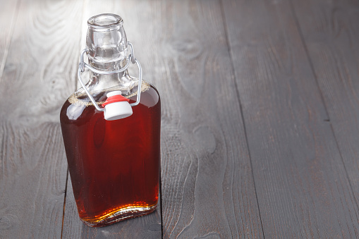 istock Homemade alcohol cordial drink in bottle on table 974185592