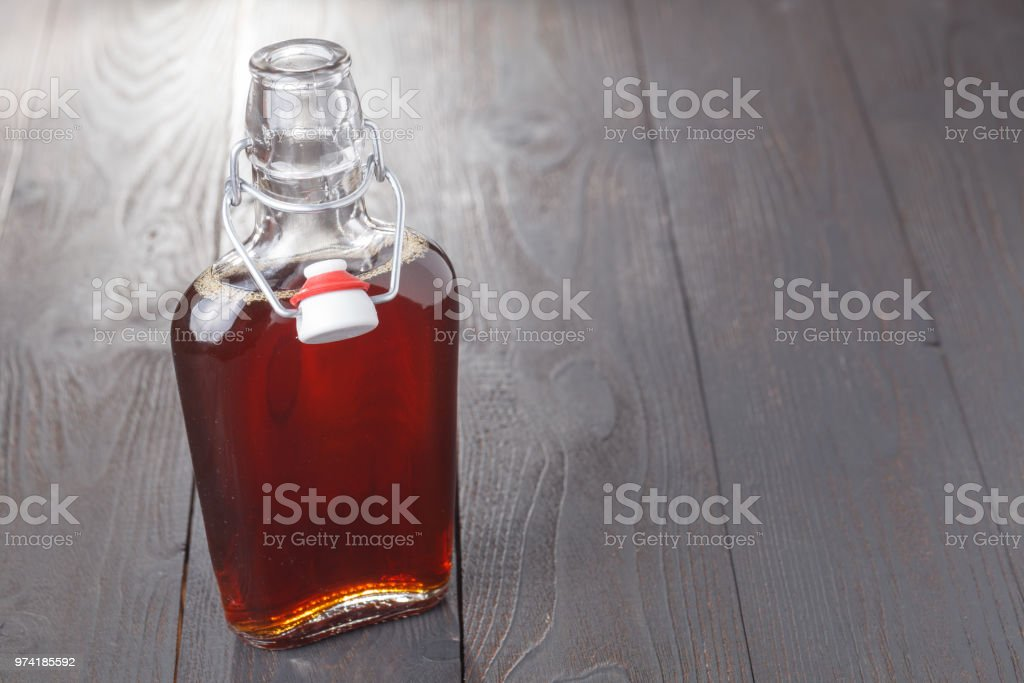 Homemade alcohol cordial drink in bottle on table stock photo